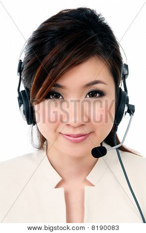 Cheerful Businesswoman Wearing Headphones
