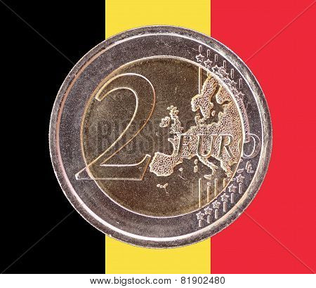 Common Face Of Two Euro Coin On Flag Of Belgium