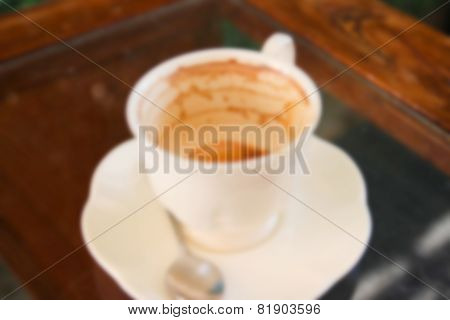 Blurry Image Of Empty Coffee Cup With Coffee Stain