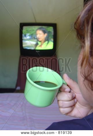 Watching TV and drinking coffee