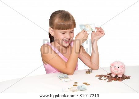 Smiling Girl With Money In Hands  Isolated