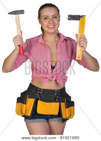 Woman in tool belt holding hammer and angle ruler