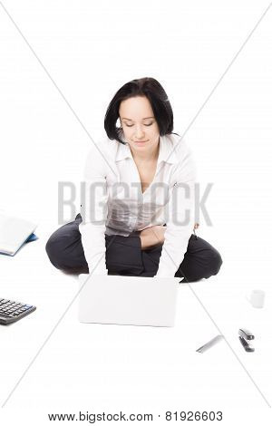 Young Female Worker Using Laptop In Lotus Pose On White Background