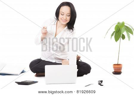 Young Businesswoman In Lotus Pose Typing On Laptop On White Background