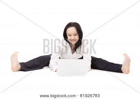 Young Office Woman Sitting In Splits With Laptop On White Background