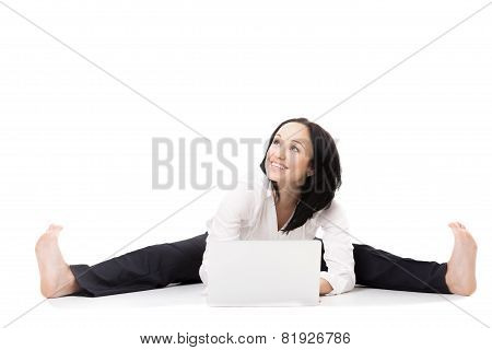 Young Office Woman With Laptop Doing Splits On White Background