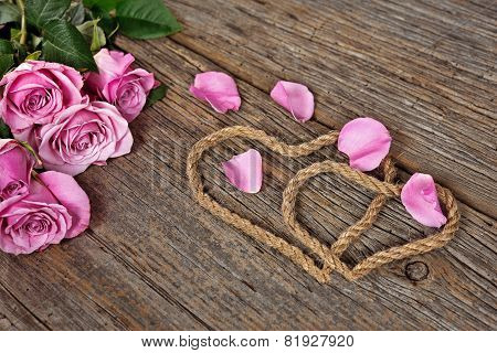 pink roses and rope hearts