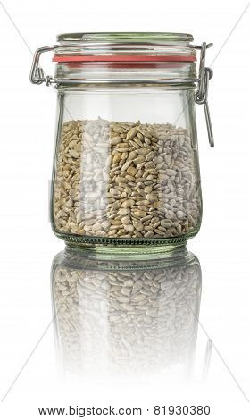 Sunflower seeds in a jar on a white background