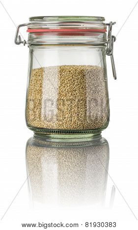 Sesame in a jar on a white background