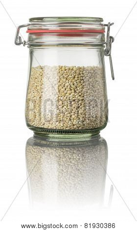 Pearl barley in a jar on a white background