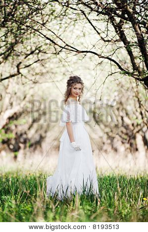 Beautiful Woman In White Dress Walking In Park