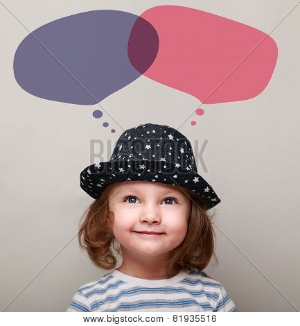 Smiling Child Dreaming About And Looking On Bubbles Above Head