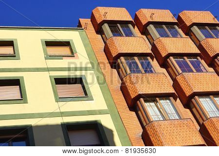 Buildings with orange, yellow and green facade
