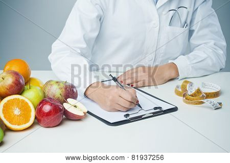 Female Nutritionist At Work