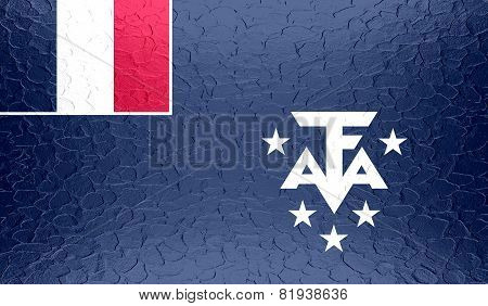 French Southern and Antarctic Lands flag on metallic metal texture