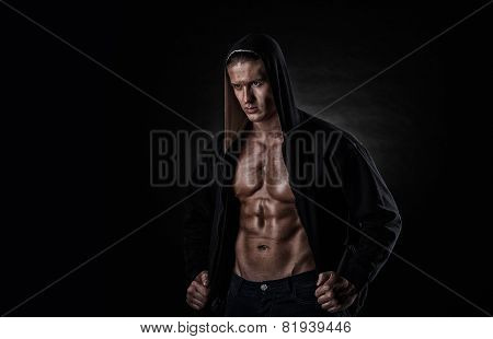 Muscular Sports Man After Weights Training Over Black Background