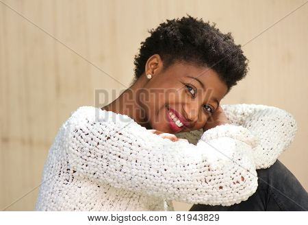 Smiling African American Woman Sitting Outdoors