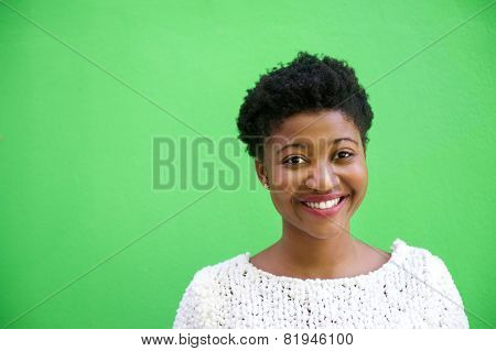 Smiling African American Woman On Isolated Green Background