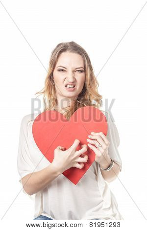 Agressive looking girl with large heart