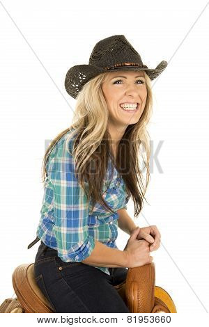 Cowgirl Sitting On A Saddle Laughing