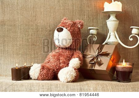 Romantic Present. Teddy Bear With Gift Box And Candles.