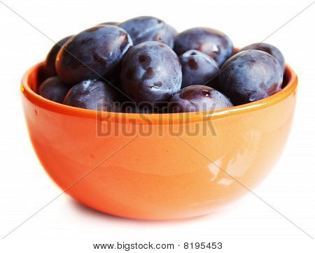 Juicy Plums On The Plate