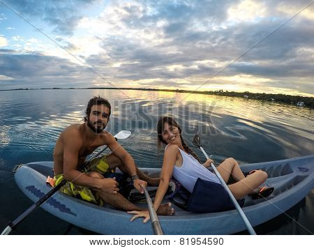 Young Couple And A Kayak On Laguna De Bacalar, Lagoon Of Mexico. Quintana Roo. Caribbean. Beautiful