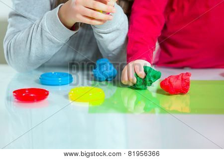 Children play with plasticine