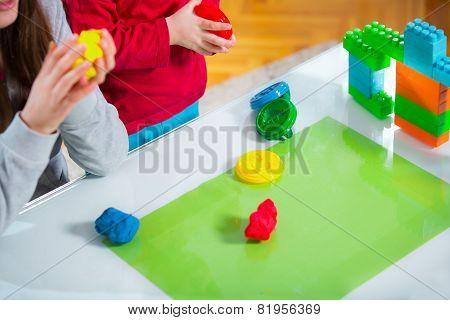 Children play with plasticine
