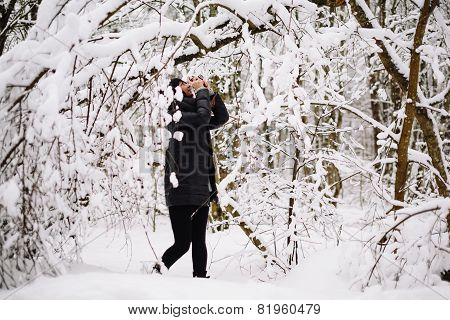 Girl photographed in snowy forest