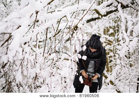 girl sneaks through the winter forest