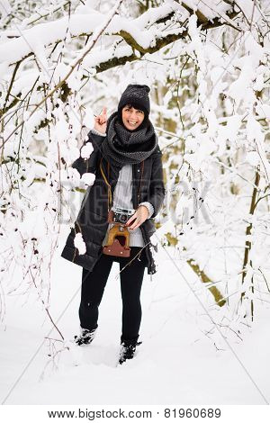Smiling brunette woman in winter forest