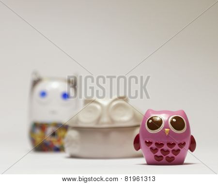 Owl figurines in row