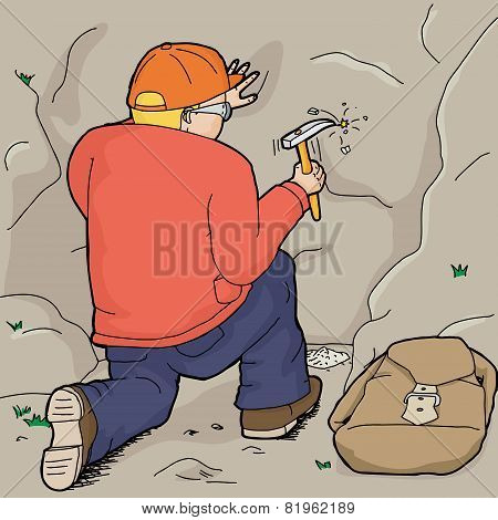Geologist Using Rock Hammer