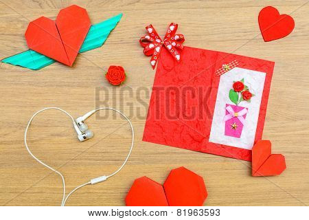 Red Heart Shape Paper On Wooden Table