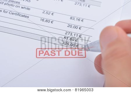 Person's Hand Over Past Due Statement