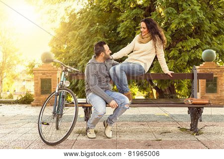 Middle Aged Couple Talking In The Park At Sunset