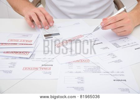 Man Calculating Unpaid Bills