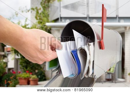 Man Taking Letters From Mailbox