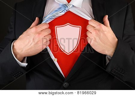 Businessman Showing A Shield Symbol