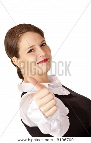 Casual young attractive businesswoman shows thumb up.