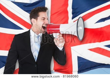 Portrait Of A Businessman Shouting Through Megaphone