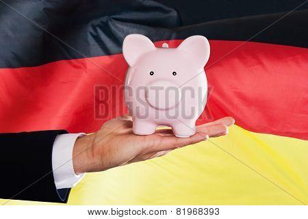 German Businessman Holding Piggybank