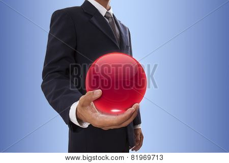 Businessman hand holding red crystal ball.