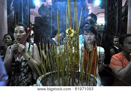 Vietnamese People Offering Incense Sticks For The Gods