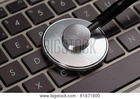 Medical Stethoscope On Laptop
