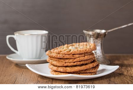 Cup Of Coffee With Tasty  Cookies And Turk For Coffee