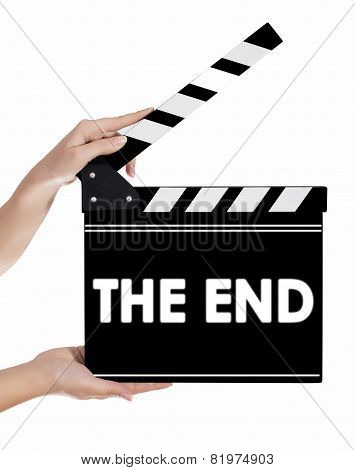 Hands Holding A Clapper Board With The End Text