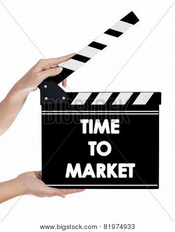 Hands Holding A Clapper Board With Time To Market Text