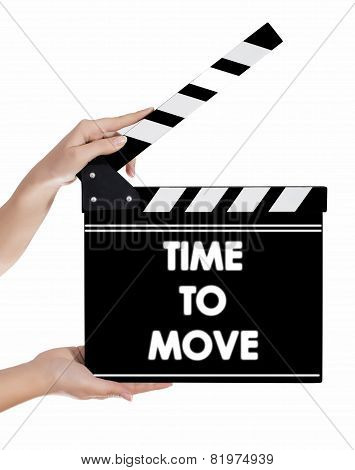 Hands Holding A Clapper Board With Time To Move Text